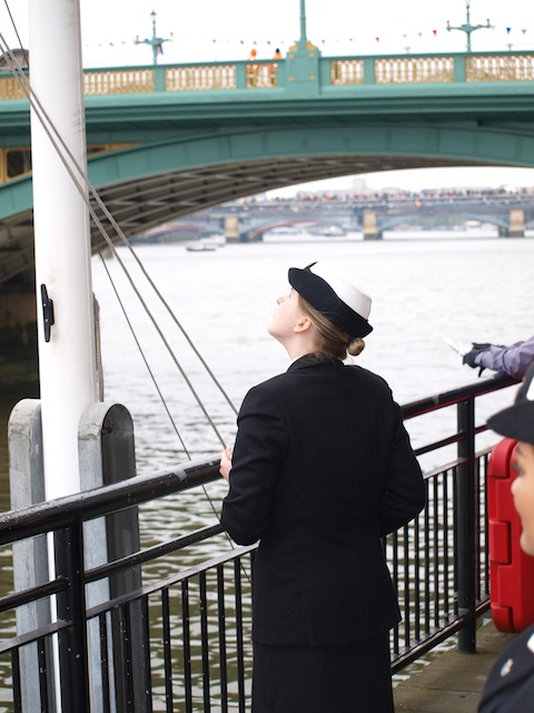 Dipping the ensign as the Queen's barge passes by