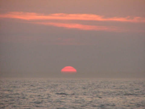 19. The Green Flash sunset prevented by a band of pollution on the horizon