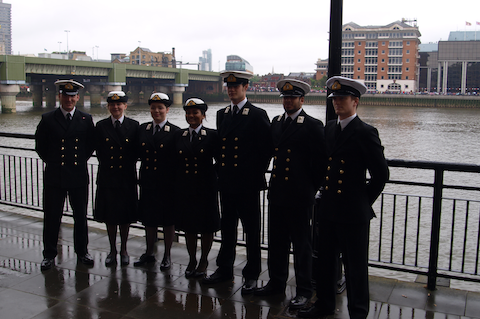 The URNU unit joined the Commodore to dip the ensign as the Queen's barge passed