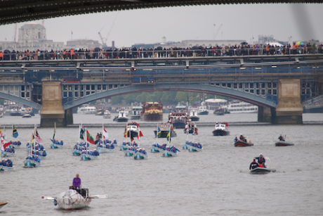 The flotilla of small boats flying Commonwealth flags above Southwark Bridge