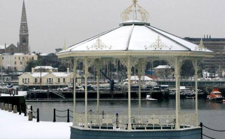 NYC Ireland pictured in the snow with bandstand in foreground (picture Chris Moo