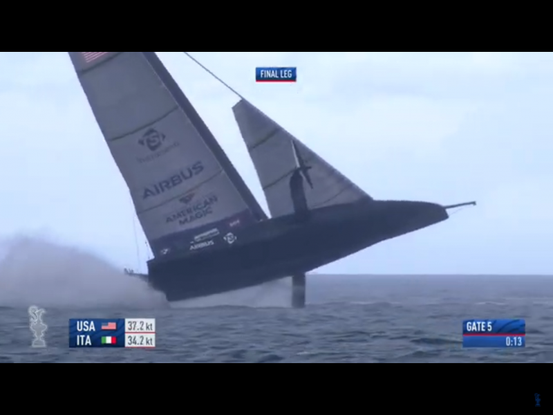 American Magic capsizes at the final mark on race 6 of Prada Cup